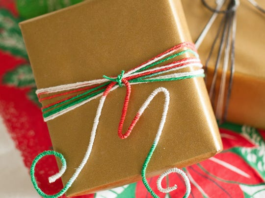 In this photo provided by HGTV, create a unique gift topper by bending 8-gauge wire into the shape of a letter then wrap it with yarn or ribbon and glue to adhere. Attach the monogram with matching yarn or ribbon to the package, says Kayla Kitts, special projects editor for HGTV.com.