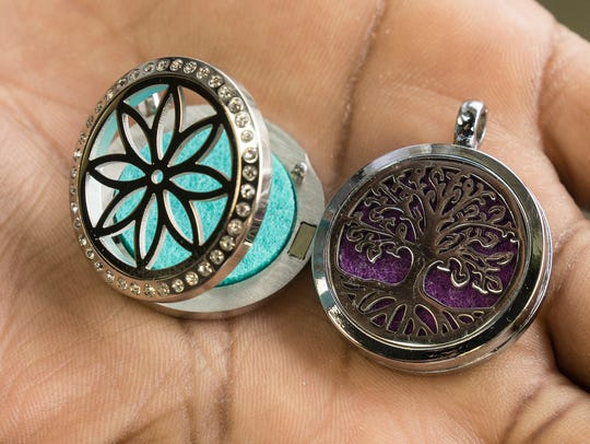 Aromatherapy lockets open so essential oils can be