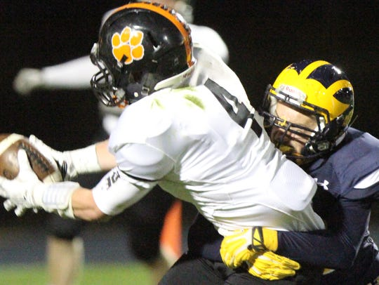 Brighton's Luke Helwing is brought down by a Hartland