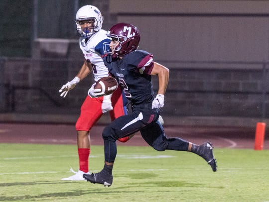 Mt. Whitney's Jonathan Hadley out runs Tulare Western's