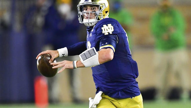 Notre Dame quarterback Ian Book looks for a receiver during the first quarter against Clemson in an NCAA college football game Saturday, Nov. 7, 2020, in South Bend, Ind.