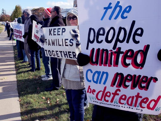People face West Moreland Boulevard in front of the Waukesha County Courthouse on Nov. 9 to protest  the Waukesha County Sheriff's Department working with federal agencies in the handling of alleged illegal immigrants through what are known at 287(g) agreements.