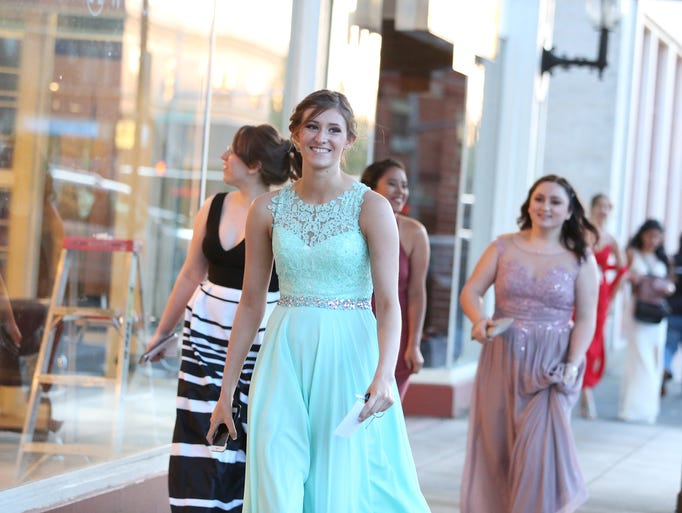 Students arrive at McKay High School's prom on Saturday,