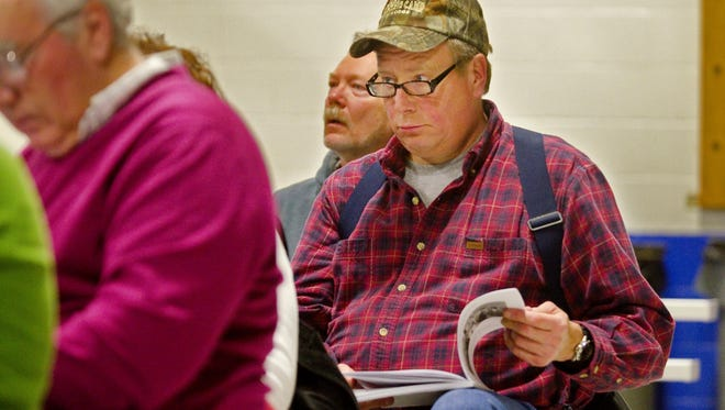 Erik Jacobsen listens to a presentation during the school budget portion of the Westford town meeting on Monday, March 5, 2012.