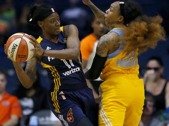 Indiana Fever guard Erica Wheeler, left, looks to pass against Chicago Sky guard Cappie Pondexter during the first half of a WNBA basketball game, Sunday, June 18, 2017, in Rosemont, Ill. (AP Photo/Nam Y. Huh)