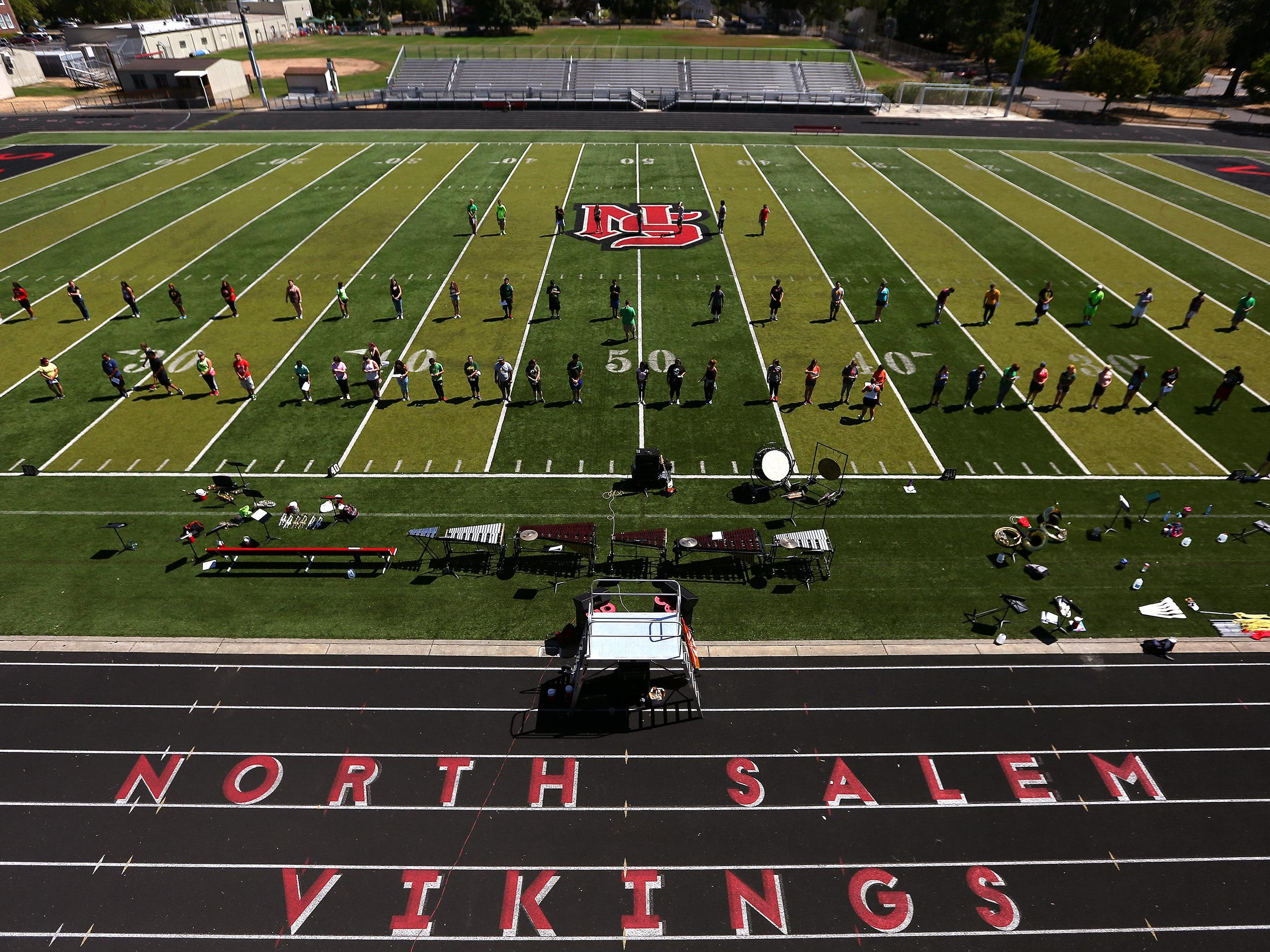 The marching band learns their steps during band camp at North Salem High School, Thursday, August 20, 2015, in Salem, Ore.