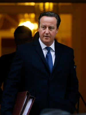 British Prime Minister David Cameron leaves Downing Street  in London on Nov. 26.