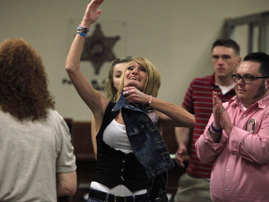 Kym Straton celebrates after Judge Vincent DiNolfo refused to allow psychiatrist William Lewek to avoid jail by going into a substance abuse treatment program.