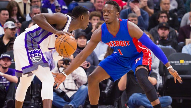 Kings guard Darren Collison (7) controls the ball as Pistons guard Reggie Jackson (1) defends during the first quarter Tuesday in Sacramento, Calif.