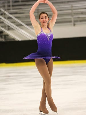 Kathleen Criss competes in the junior championship free skate during the U.S. Figure Skating Intercollegiate Championships at the Fred Rust Arena in Newark Saturday.