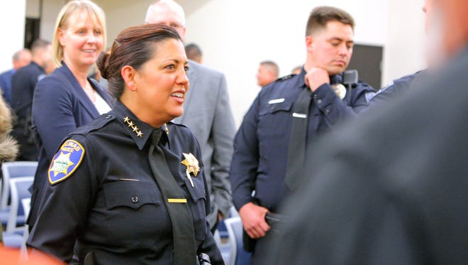 Salinas Police Chief Adele Fresé smiles in the audience during her swearing in on Friday.