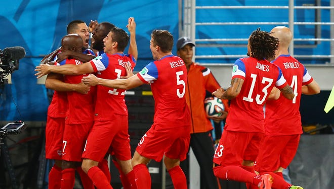 USA forward Clint Dempsey (left) is congratulated by teammates after scoring a goal in the first half against Ghana during the 2014 World Cup at Estadio das Dunas.