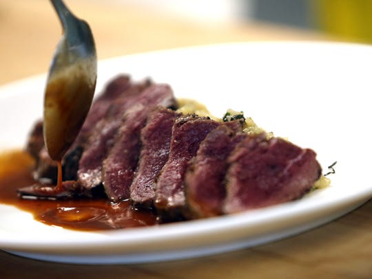 Vice President Ben DelCoro cooks up an ostrich fillet