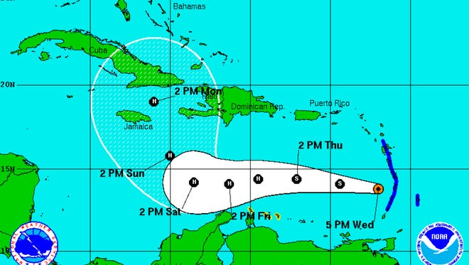 A graphic from the National Hurricane Center shows the position and forecast track of Tropical Storm Matthew as of 5:00 p.m., Wednesday, September 28.