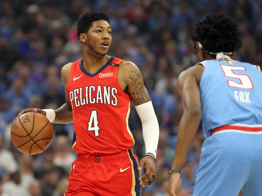 Apr 7, 2019; Sacramento, CA, USA; New Orleans Pelicans guard Elfrid Payton (4) dribbles the ball while being defended by Sacramento Kings guard De'Aaron Fox (5) during the first quarter at Golden 1 Center. Mandatory Credit: Darren Yamashita-USA TODAY Sports