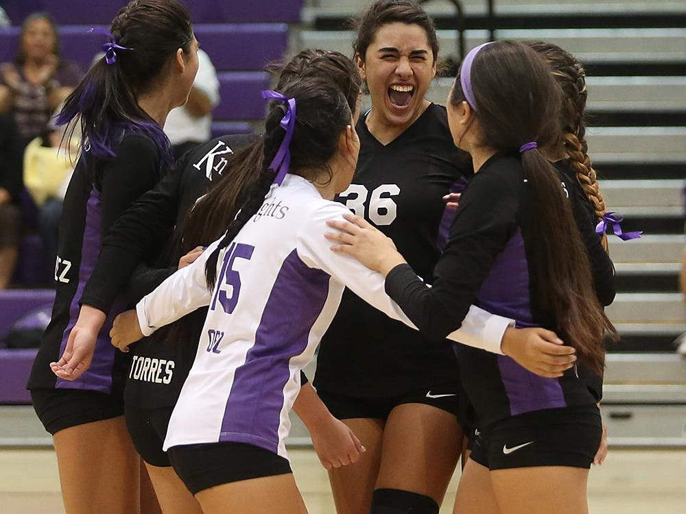 In this November 2014 photo, the Lady Knights celebrate as Shadow Hills scores a point against CAMS in the opening CIF volleyball playoff match. Shadow Hills went on to win in straight sets.