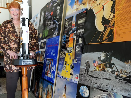 Nancy Kidd, a former Department of Defense employee shown standing next to a Saturn V Rocket miniature rocket, is putting together Rocket Day on Saturday at Strathearn Historical Park & Museum in Simi Valley.