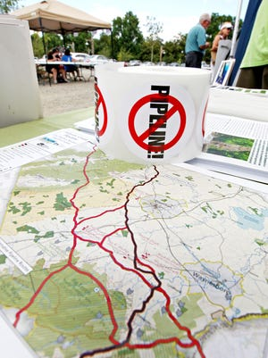 A map of Augusta County shows the Atlantic Coast Pipleline routes, as proposed by Dominion, at the tent of the Augusta County Alliance at the Music for the Mountains festival at Devil's Backbone Brewery in Roseland on Saturday, July 18, 2015. The festival was created to raise funds to fight the Atlantic Coast Pipeline.