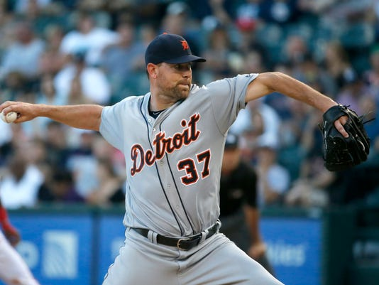 Detroit Tigers starting pitcher Mike Pelfrey delivers during the first inning of a baseball game against the Chicago White Sox Wednesday, June 15, 2016, in Chicago. (AP Photo/Charles Rex Arbogast)