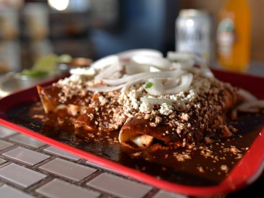 Enchilada supreme de pollo at Panchos Mexican Taqueria,