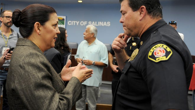 Greenfield Police Chief Adele Frese speaks with Salinas Fire Chief Ed Rodriguez following the announcement of her appointment as the next Salinas police chief.