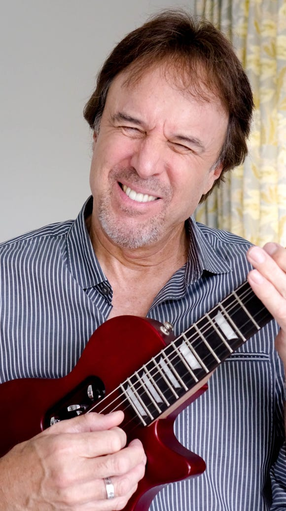 Comedian Kevin Nealon at home with the Traveler Guitar.