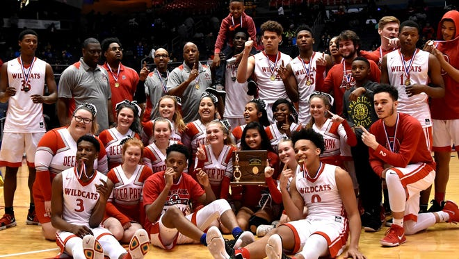 Deer Park's Wildcats celebrate their Division 3 SWDAB District title with their fans at University of Dayton Arena, March 7, 2018.