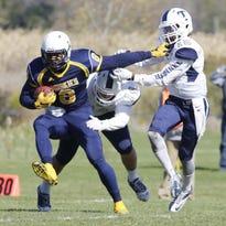 Lakeland's Michael Esiobu (6) carries the ball against Trine University Saturday October 17, 2015 at Lakeland.