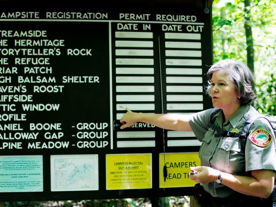 Sue McBean, superintendent of Grandfather Mountain State Park explains how to register for a campsite in the park June 10.