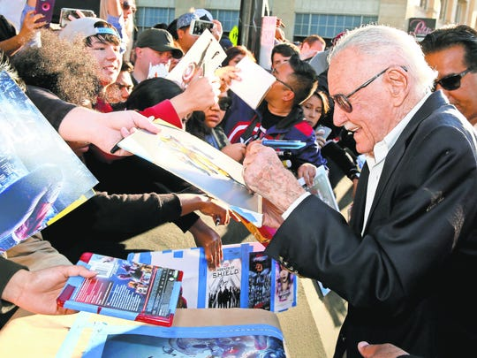 Stan Lee signing autographs.