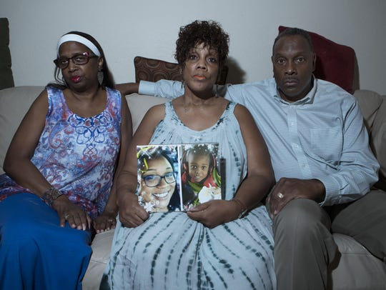Juanita Jones, Angelia Bridges and Lavelle Bridges pose at Angela's house on Thursday, July 27, 2017 in El Mirage, Ariz. Bridges' daughter and grandson were killed in an apartment fire in Mesa last May.