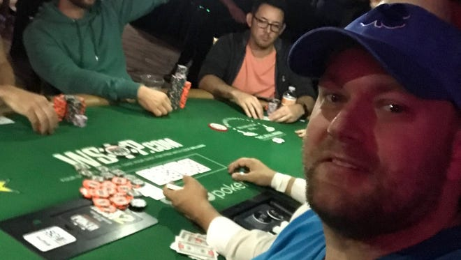 Muskegon's Nic Manion is shown at the WSOP Main Event tables late Monday night, after the Rio suffered a power outage that ended play early for the day.