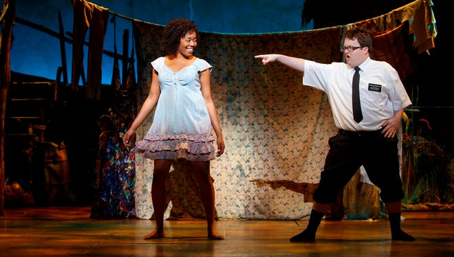 "Candace Quarrels is amused by visiting missionary Cody Jamison Strand in ""The Book of Mormon."""