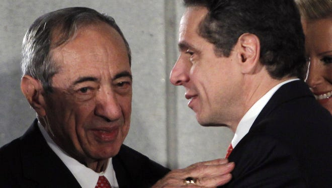 New York Gov. Andrew Cuomo, right, talks with his father and former New York Gov. Mario Cuomo, during a swearing-in ceremony in the War Room at the Capitol in Albany on Jan. 1, 2011. Mario Cuomo died Jan. 1, 2015 at age 82.