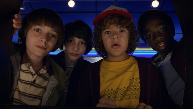 "Cast members Noah Schnapp, Finn Wolfhard, Gaten Matarazzo and Caleb McLaughlin visit a Hawkins, Ind., arcade in the first episode of ""Stranger Things 2."""