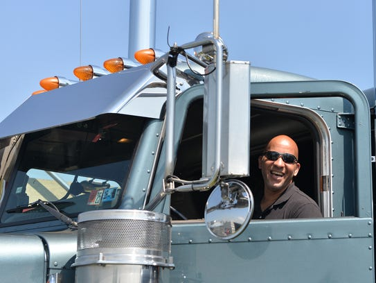 David Hughes of Souderton, Pa., smiles from the cab
