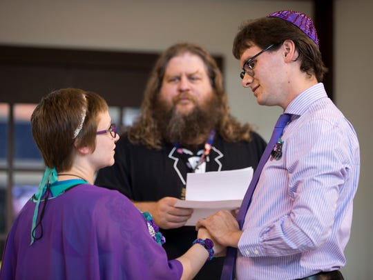 Troy Maynard, Bloomington, oversees a renewal of vows