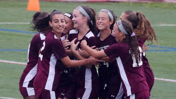 Alberts Magnus players celebrate a first half goal by Lily Winters against Irvington on Sunday during the girls soccer sectional final at Arlington High School in Lagrangeville. Magnus won the game 3-2.