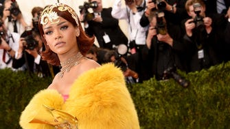 """Rihanna gets into the theme of the """"China: Through The Looking Glass"""" Costume Institute Benefit Gala at the Metropolitan Museum of Art on May 4, 2015 in New York."""