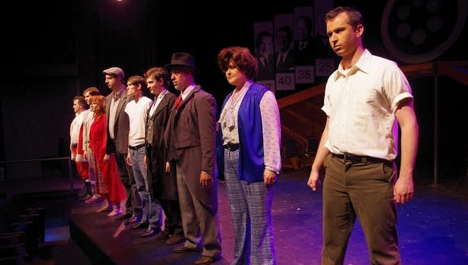"""The cast of New Stage Theatreworks' """"Assassins"""" strikes a pose."""