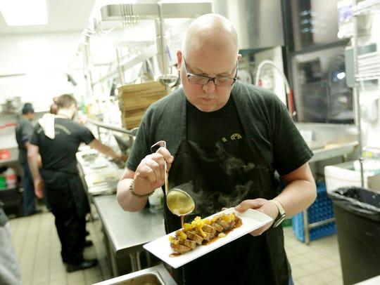 In January 2015, Chef and partner Marc Djozlija prepares