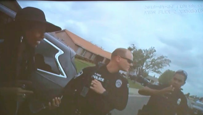 This April 30, 2018 image taken from video of body camera footage released by the Rialto Police Department and provided by KABC-TV, shows a woman outside a car pulled over by police in Rialto, Calif. Donisha Prendergast, granddaughter of reggae legend Bob Marley, plans to sue the department, saying she and a group of friends were racially profiled while leaving an Airbnb.
