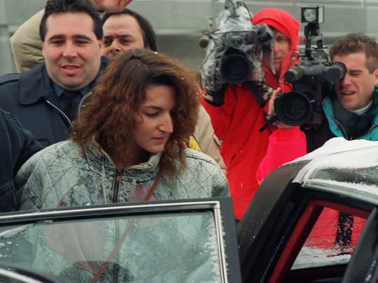 Michele Lodzinski gets into a car after appearing before a Union County grand jury Jan. 26, 1994, in Elizabeth. Lodzinsk was charged Wednesday with her son's murder.