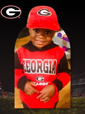 Jackson Kelley of Lithonia, who turns 3 in December, in a UGA fan cutout. (photo via UGA athletics).