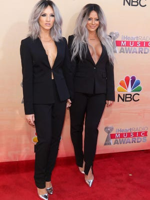 """Shannon Bex, left, and Aubrey O'Day, a La Quinta High School graduate, arrives at the iHeartRadio Music Awards at The Shrine Auditorium on March 29, 2015, in Los Angeles. The pair calls themselves """"Dumblonde"""" and will release their first album next month."""