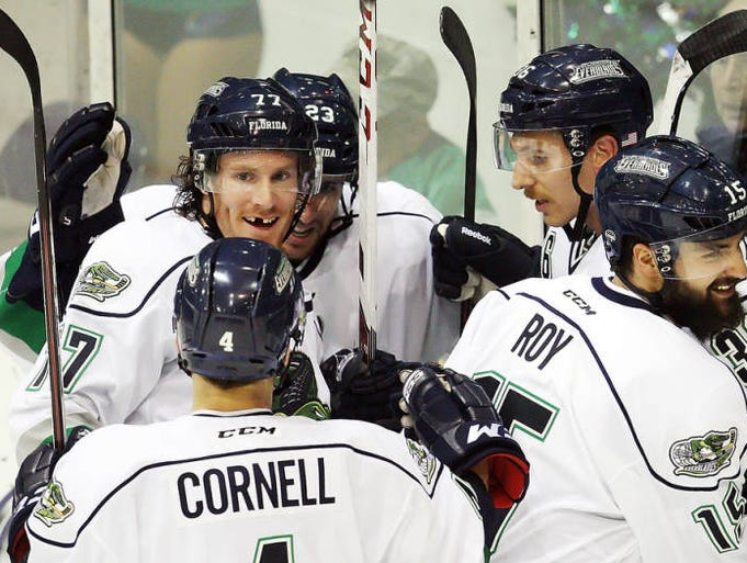 Florida Everblades players celebrate scoring a first period goal against Elmira on Wednesday at Germain Arena.