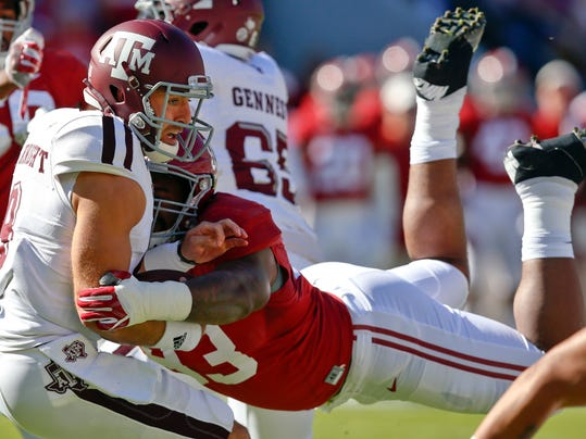 FILE - In this Oct. 22, 2016, file photo, Alabama defensive lineman Jonathan Allen (93) sacks Texas A&M quarterback Trevor Knight during the first half of an NCAA college football game,in Tuscaloosa, Ala. The Southeastern Conference's two stingiest defenses will take the field in the league championship game.  (AP Photo/Brynn Anderson, File)