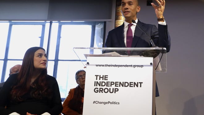 Chaka Umunna speaks alongside Luciana Berger during a press conference to announce the new political party, The Independent Group, in London, Feb. 18, 2019. Seven British Members of Parliament say they are quitting the main opposition Labour Party over its approach to issues including Brexit and anti-Semitism.