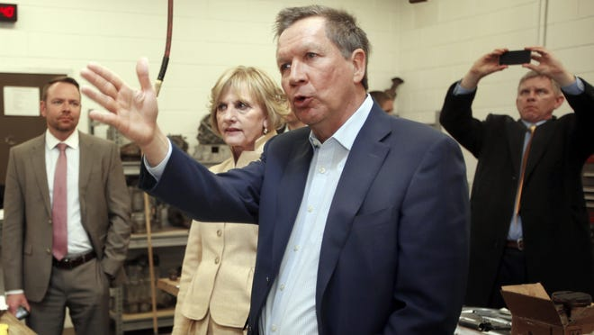 Ohio Gov. John Kasich, shown in March, will issue his budget vetoes on Tuesday.