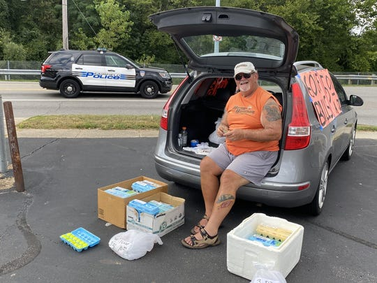"""Chuck Osso of Fairfield sells golf balls out of egg cartons across the street from Huffman Park in Fairfield, outside of Cincinnati. He says Trump supporters still hear echoes of Hillary Clinton's """"deplorable"""" comment in the 2020 election.""""This election isn't about Democratic policies or Republican politics,"""" he said. """"It's about the Trumpsters against the people who hate them."""""""